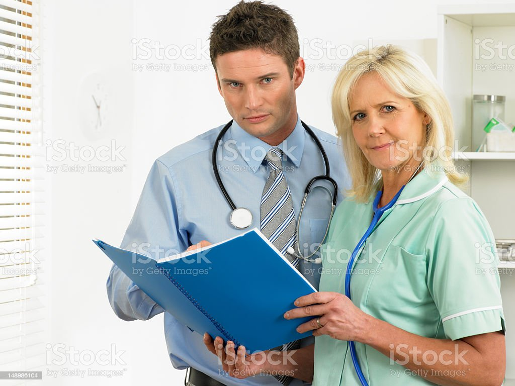 Serious Doctor and Nurse stock photo