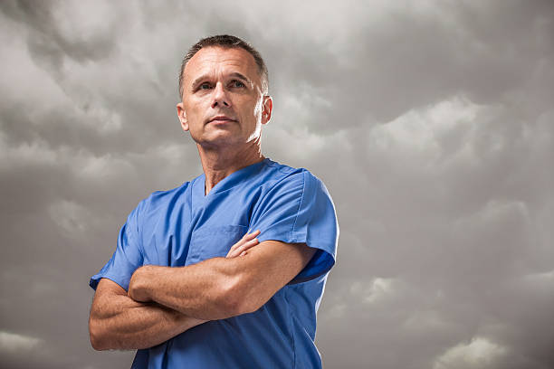 Serious Doctor with Ominous Cloudy Sky stock photo