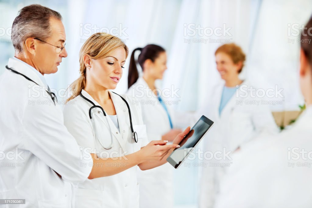 Serious doctor with touchpad. royalty-free stock photo