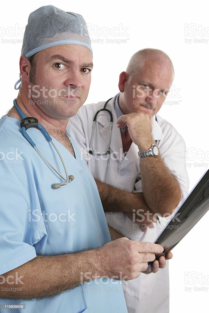 Serious Doctors With Xrays royalty-free stock photo