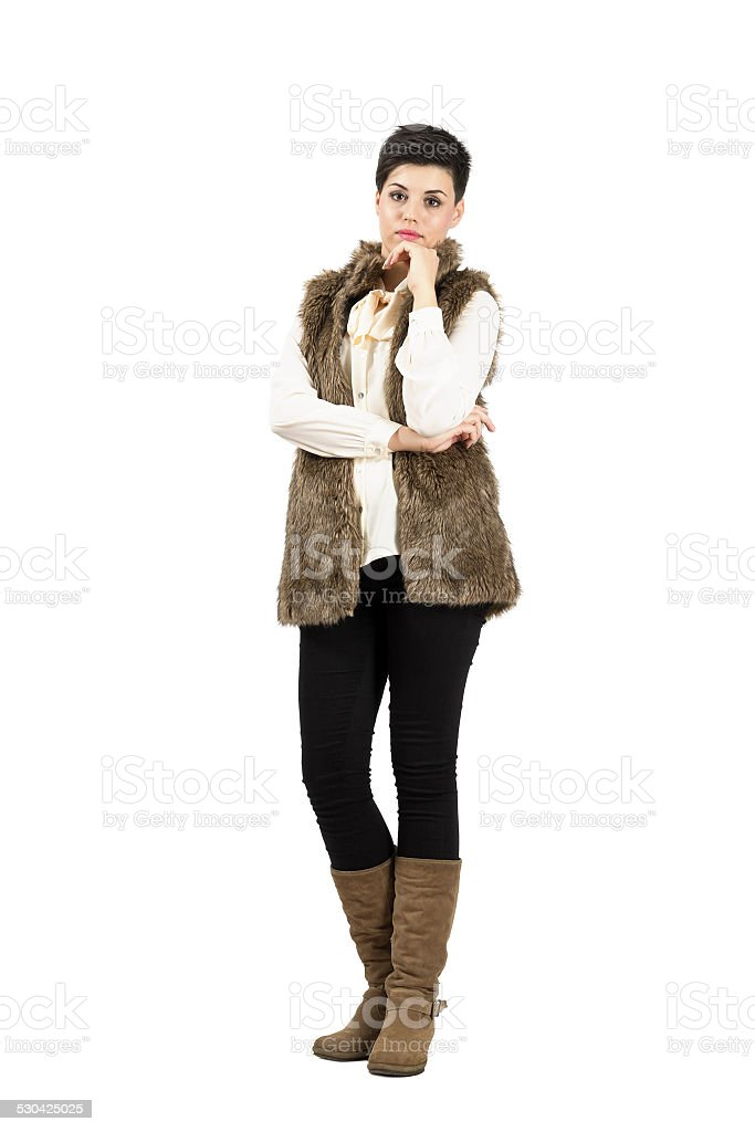 Serious doubtful woman in warm clothes looking at camera stock photo