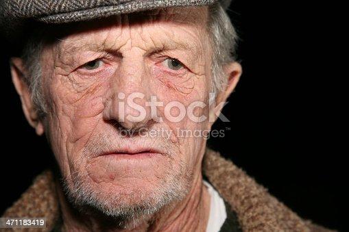 istock Serious Elderly Man Looking Down 471183419