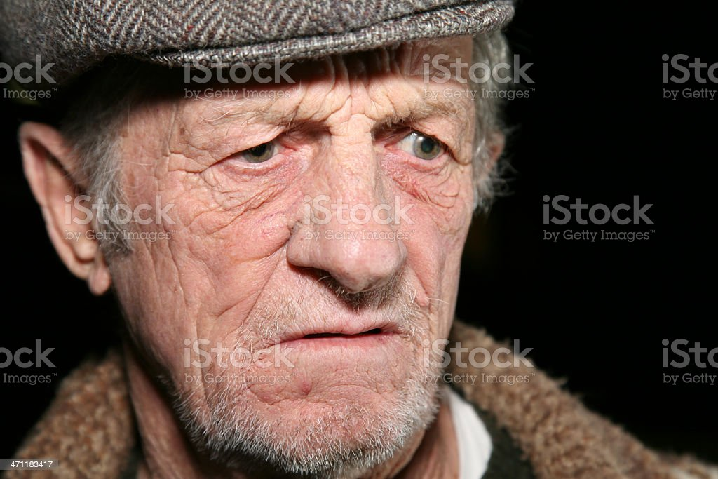 Serious Elderly Man With A Hat On royalty-free stock photo