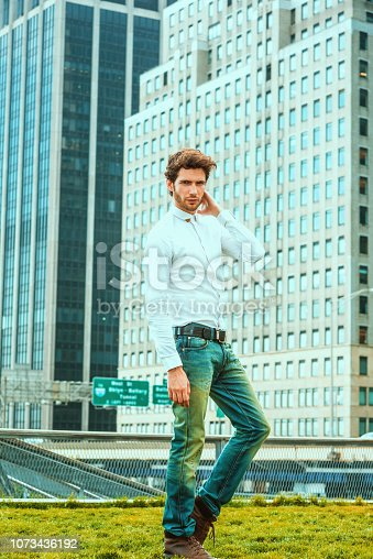 istock Serious European businessman traveling, working in New York 1073436192