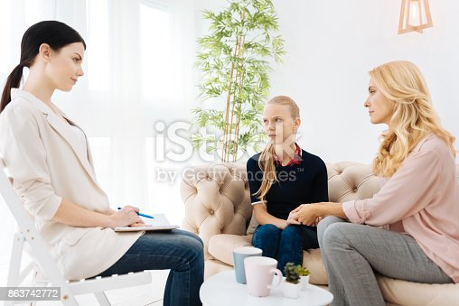 istock Serious experienced psychologist listening to her patients 863742772