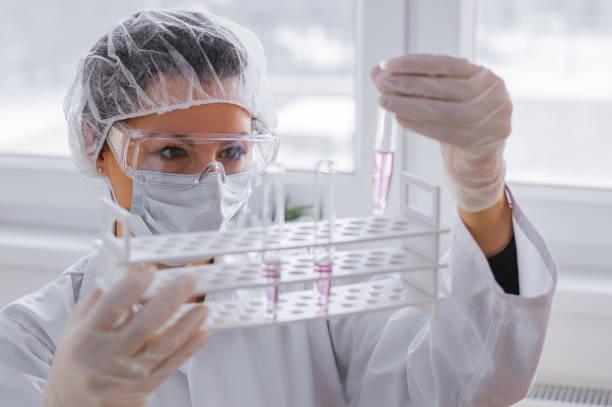 serious female chemist working in laboratory - pharmaceutical factory stock pictures, royalty-free photos & images