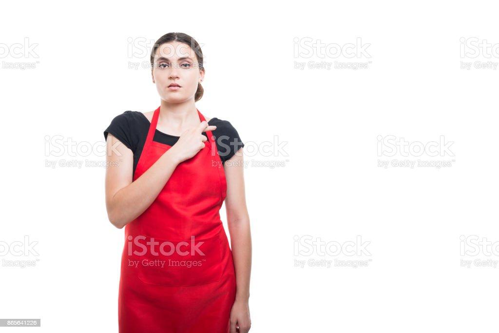 Serious female clerk doing a fake promise stock photo