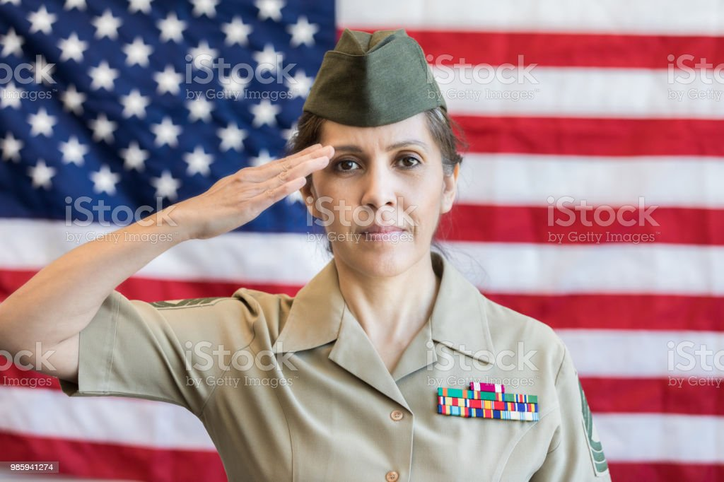 Serious Female Military Officer Salutes American Flag Stock Photo ... 25473e5966df