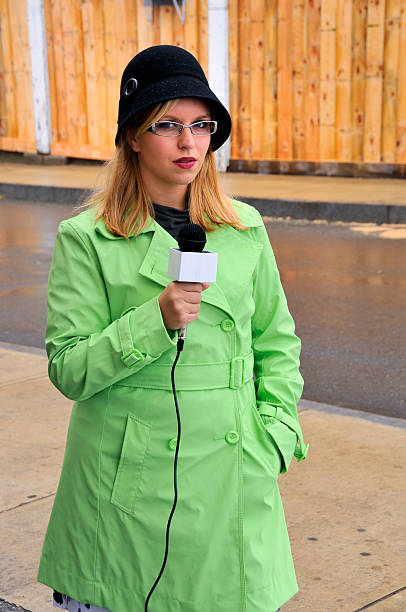 Serious Female Reporter in the Streets stock photo