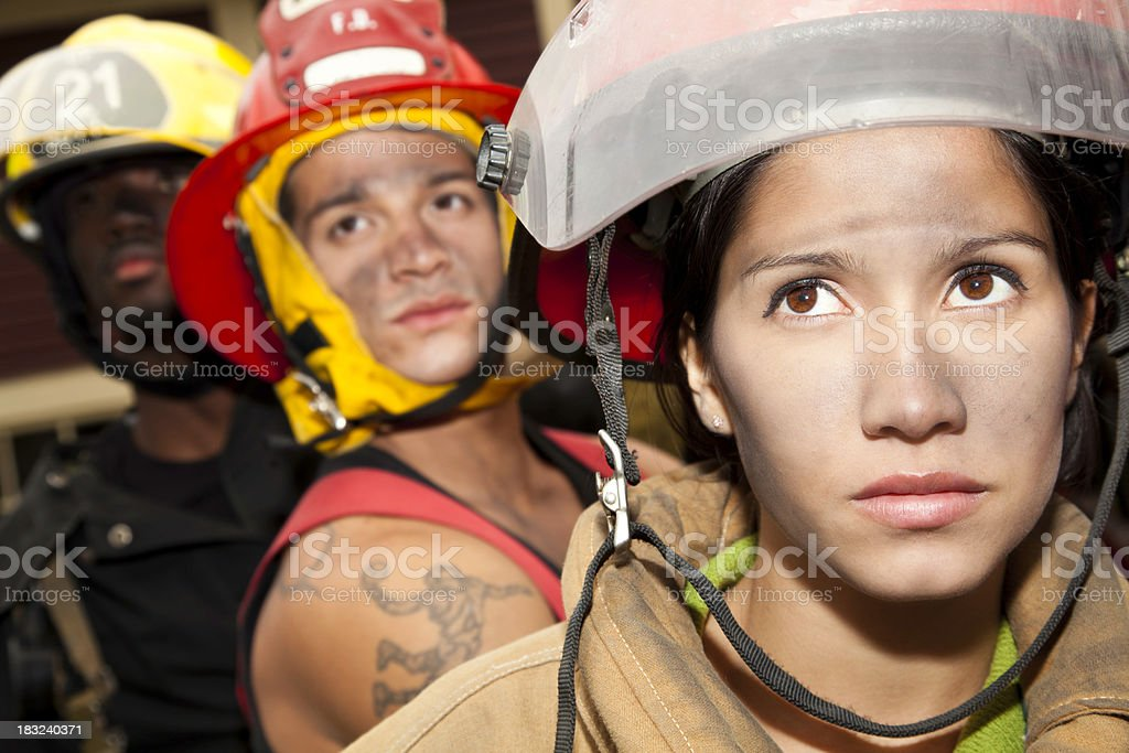 Serious Firefighters Looking Up at Fire royalty-free stock photo