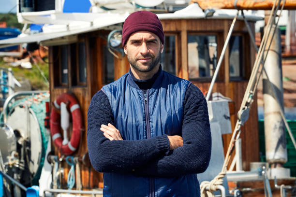 Serious fisherman fashion Serious fisherman fashion of knitwear and hat, portrait fisherman stock pictures, royalty-free photos & images