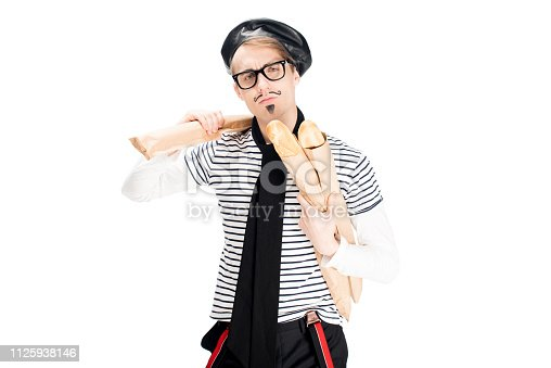 serious french man in glasses holding tasty baguettes isolated on white