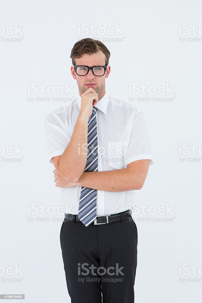 Serious geeky businessman thinking and holding his chin stock photo