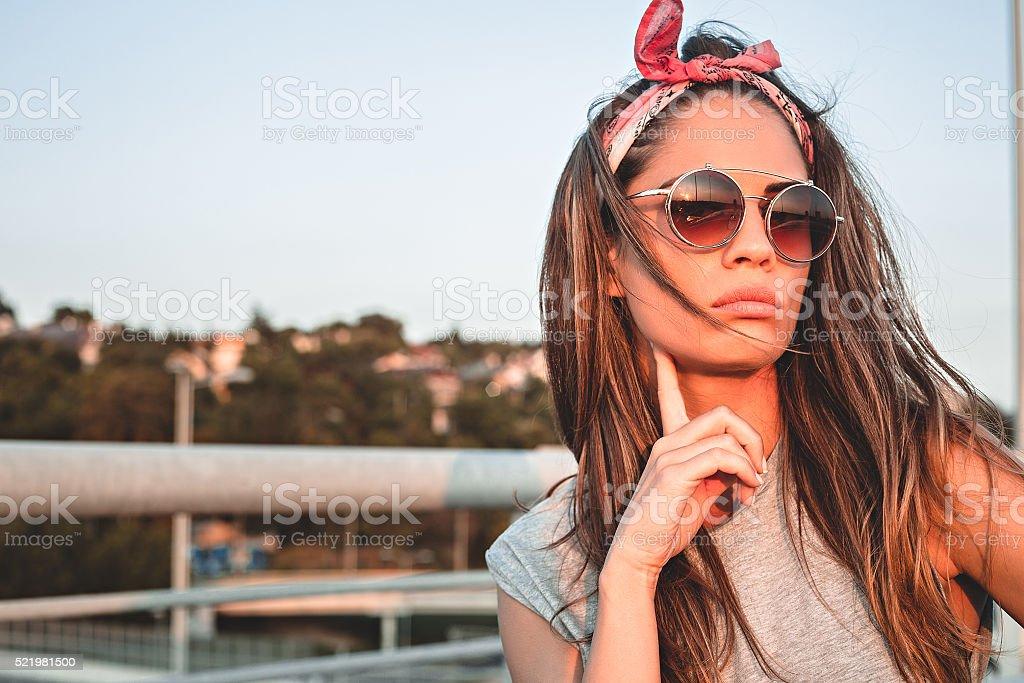 Serious girl posing on the bridge stock photo