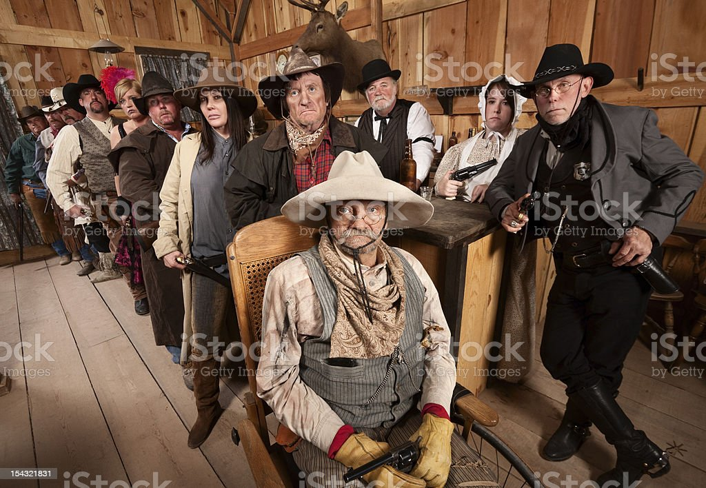 Serious Group of People in Old West Tavern stock photo