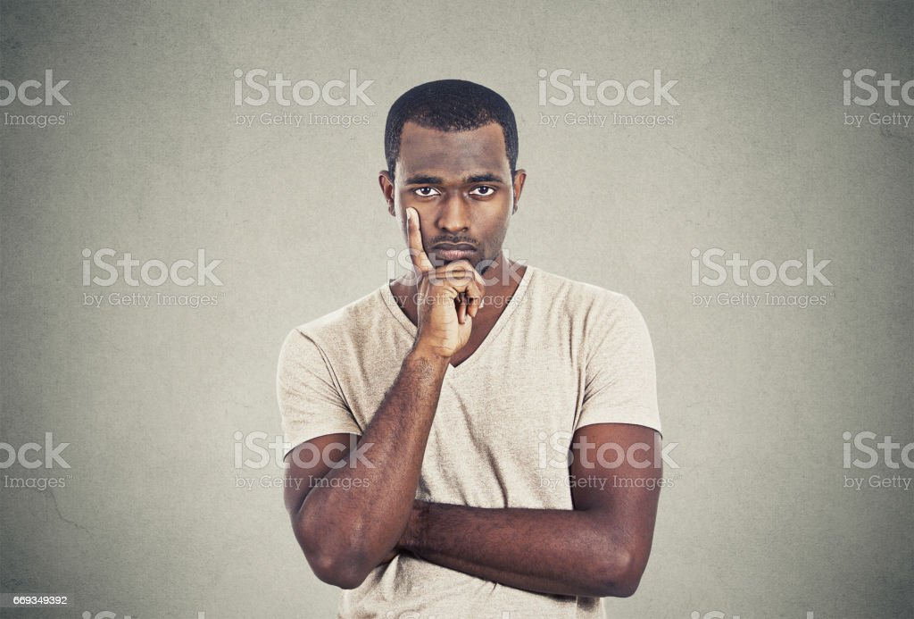 Serious handsome man with skeptical look stok fotoğrafı