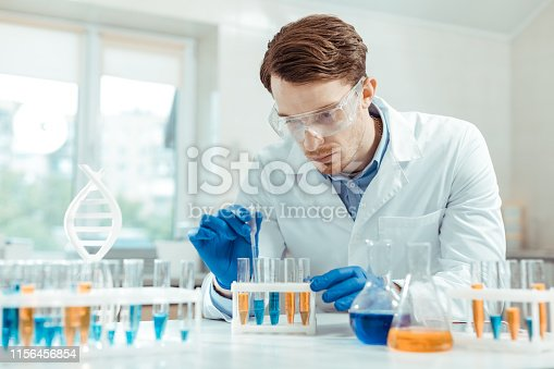 istock Serious handsome scientist wearing special protective glasses 1156456854