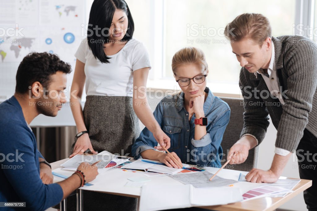 Serious hard working colleagues looking for new ideas royalty-free stock photo