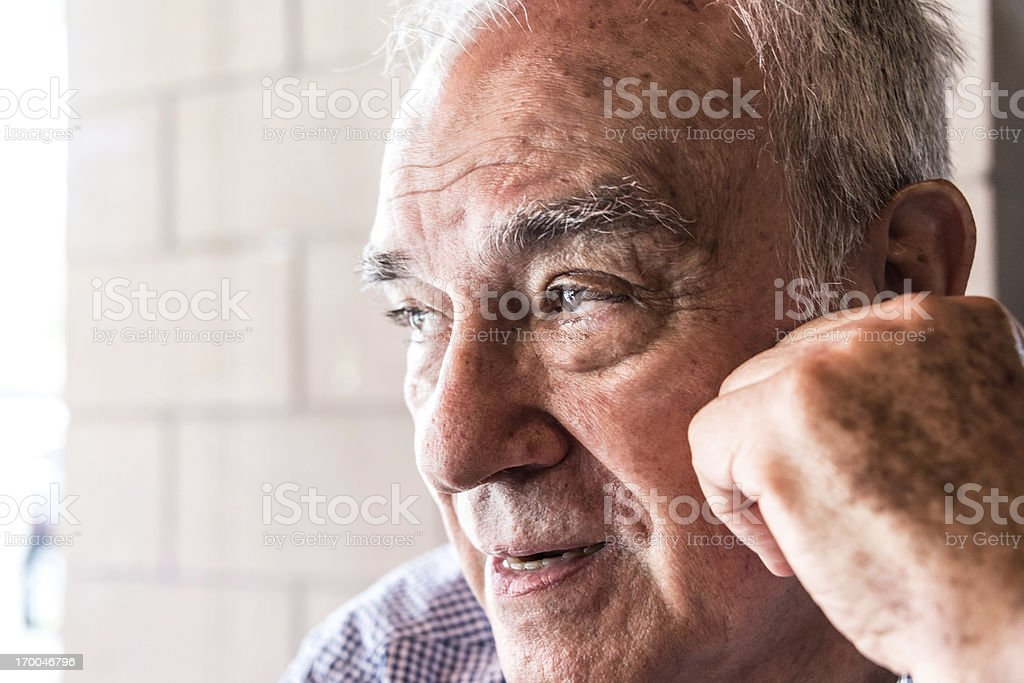 Serious hispanic senior man royalty-free stock photo