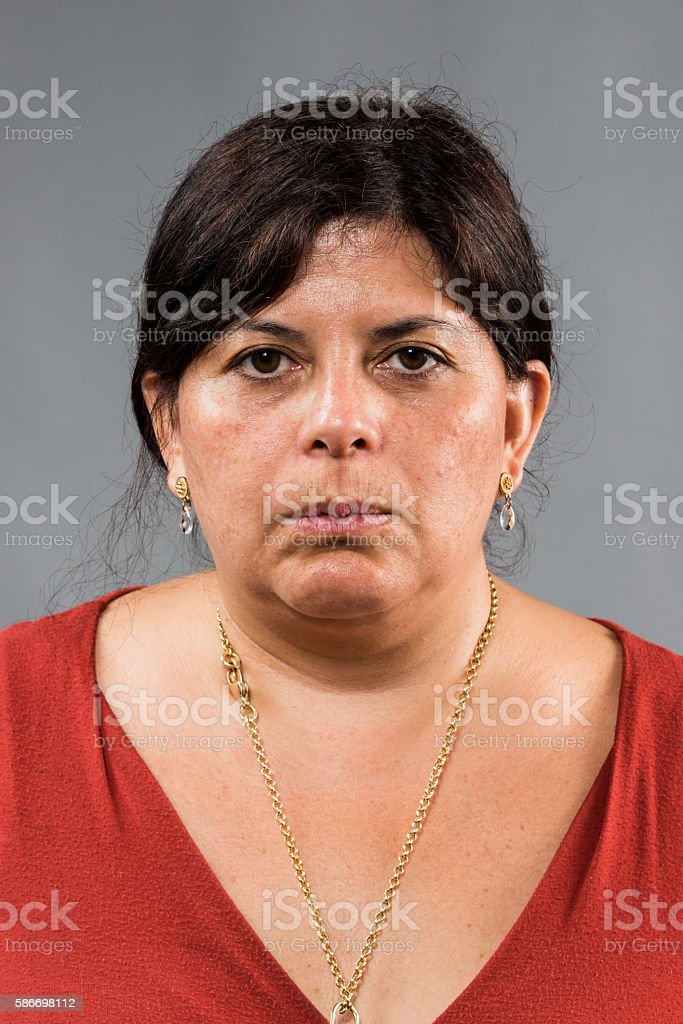 Serious hispanic woman stock photo