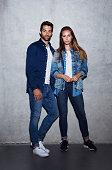 Serious couple in denim fashion, portrait