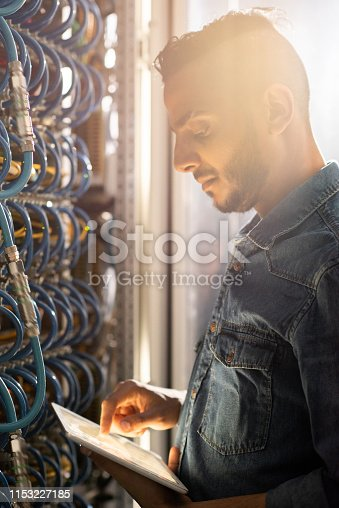 istock Serious IT engineer viewing test results 1153227185