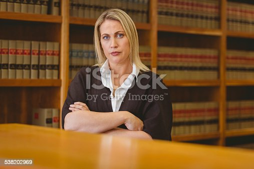1070981872istockphoto Serious lawyer looking at camera with arms crossed 538202969