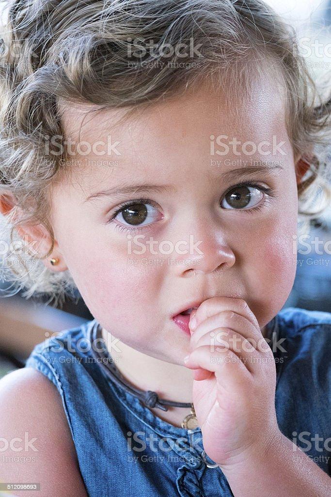 Serious little girl stock photo