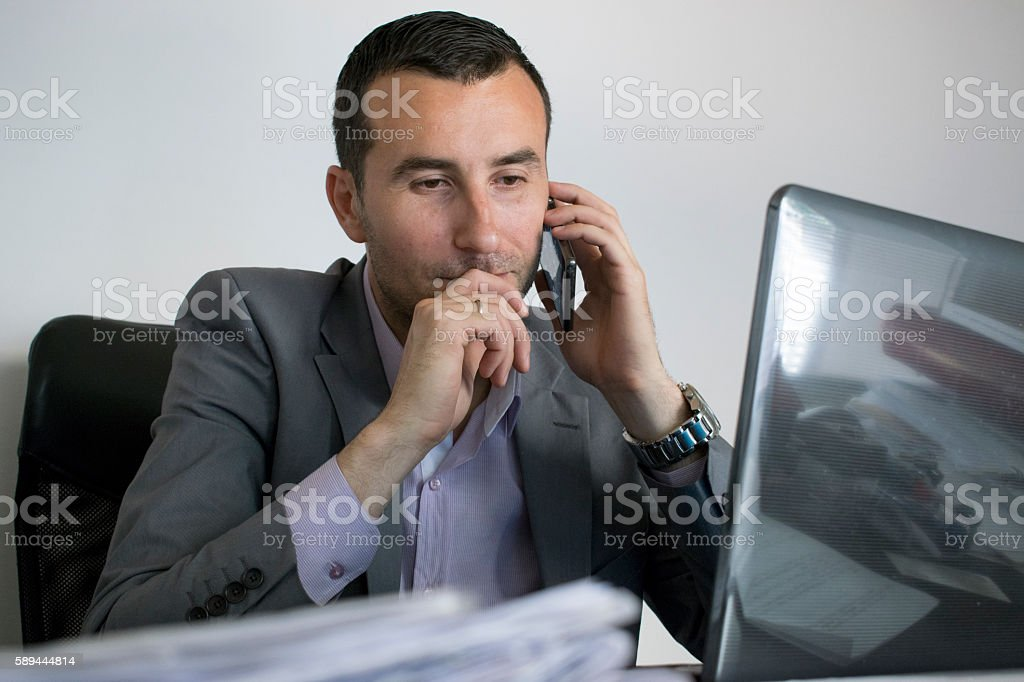 Serious look of concern on businessman face stock photo