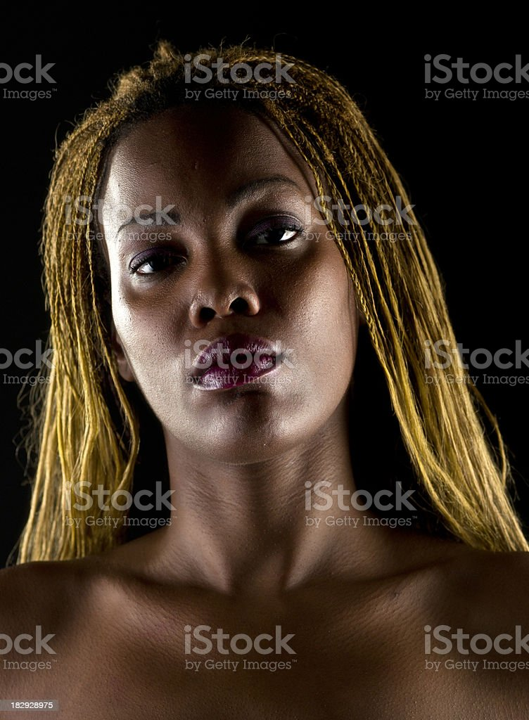 Serious looking blonde woman stock photo