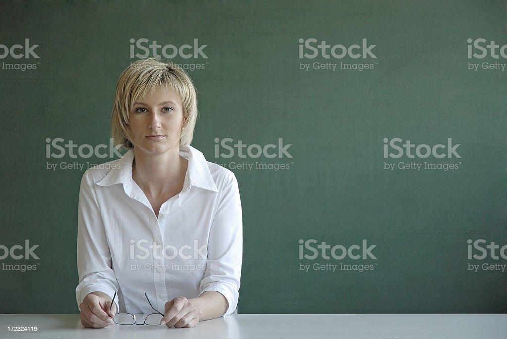 serious looking female teacher stock photo