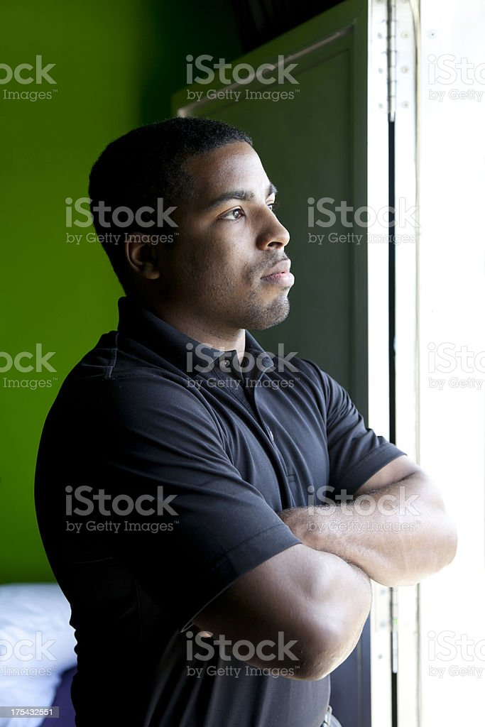 Serious Looking Man Arms Folded royalty-free stock photo