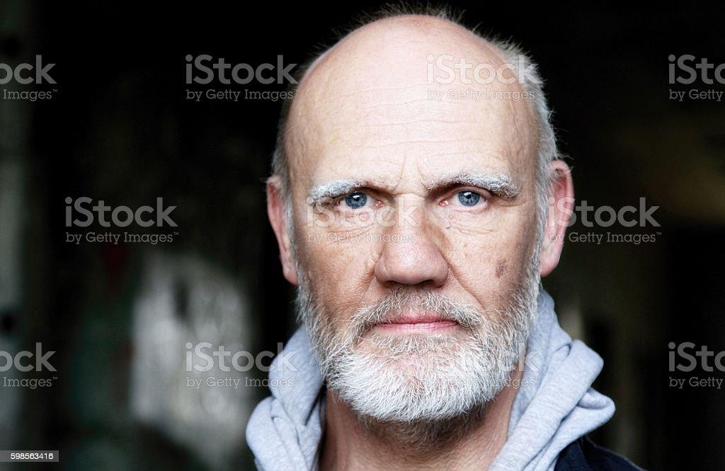 serious looking mature man stock photo