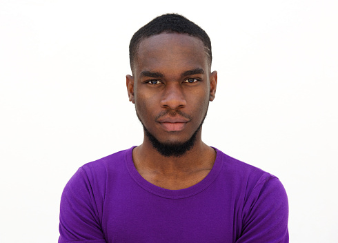 Serious Looking Young African Man Stock Photo - Download Image Now