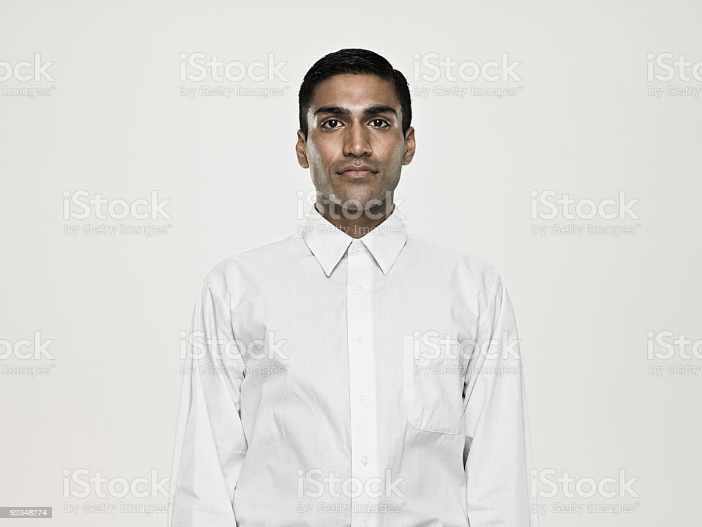 Serious looking young asian man stock photo