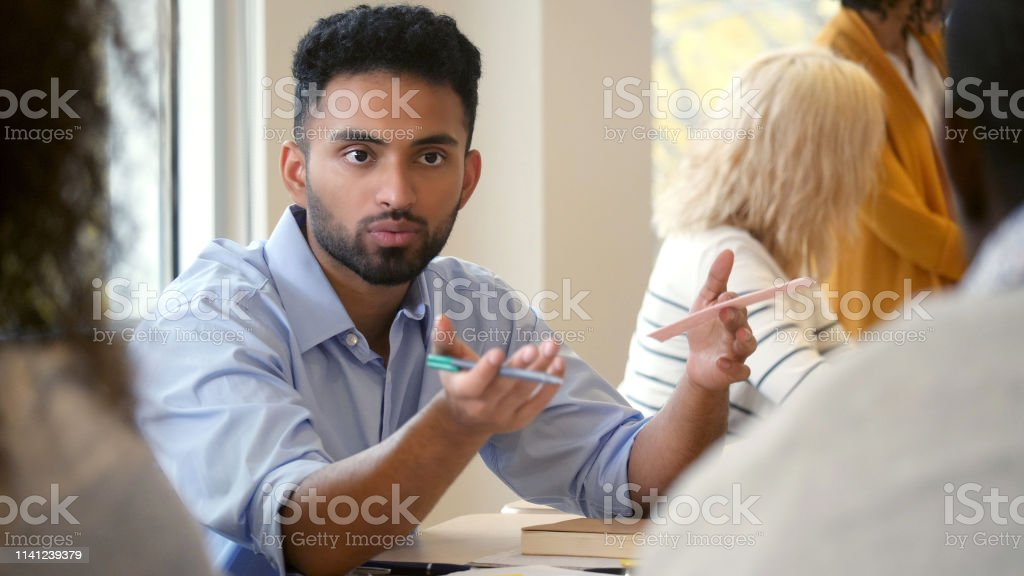 Young male design professional gestures as he has a serious...