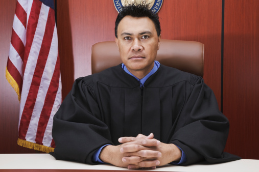 Male judge in the courtroom.