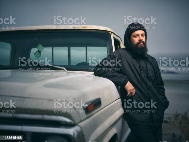 Photo of Serious Man and 50 Year Old Truck