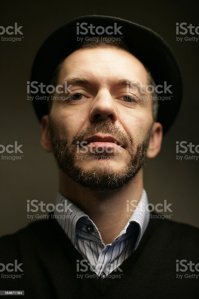 Serious man face in shirt and sweater with hat royalty-free stock photo