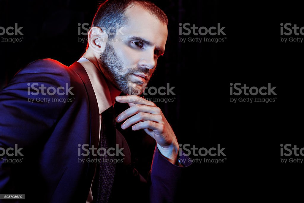 serious man in a business suit, dark background stock photo