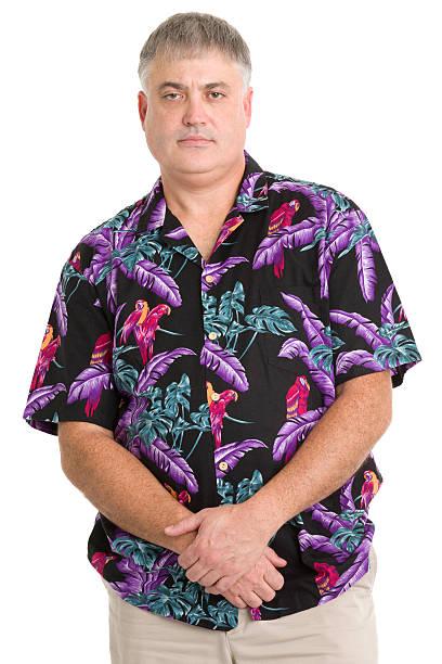 serious man in hawaiian shirt posing - korte mouwen stockfoto's en -beelden