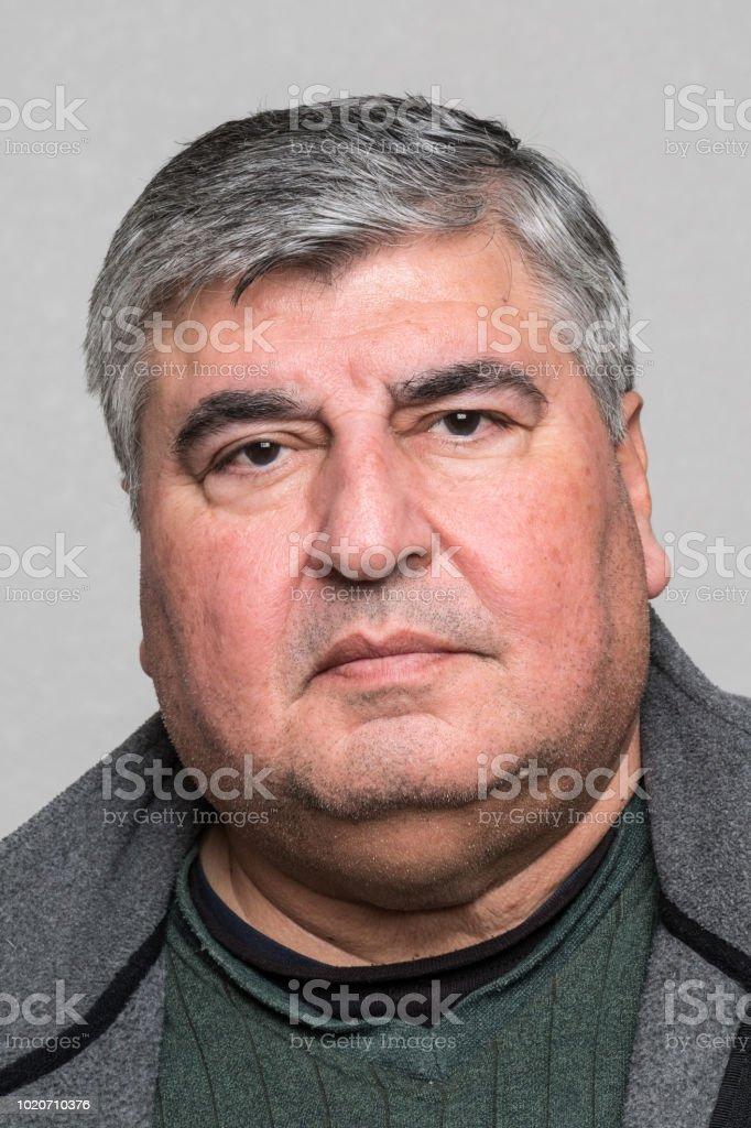 Serious man looking at the camera stock photo