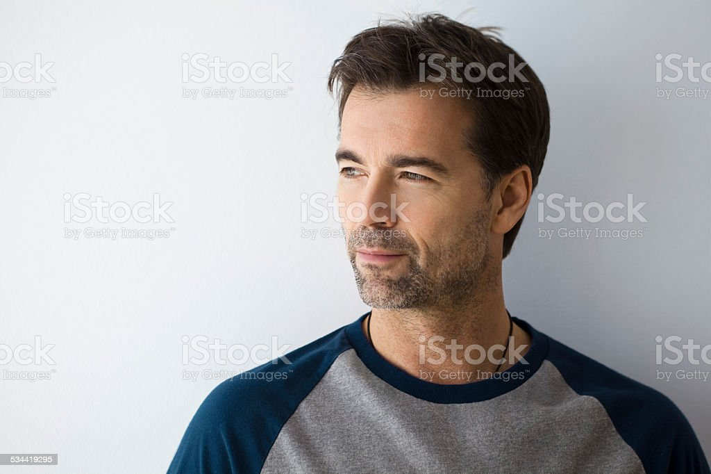 Serious Man Looking Away stock photo