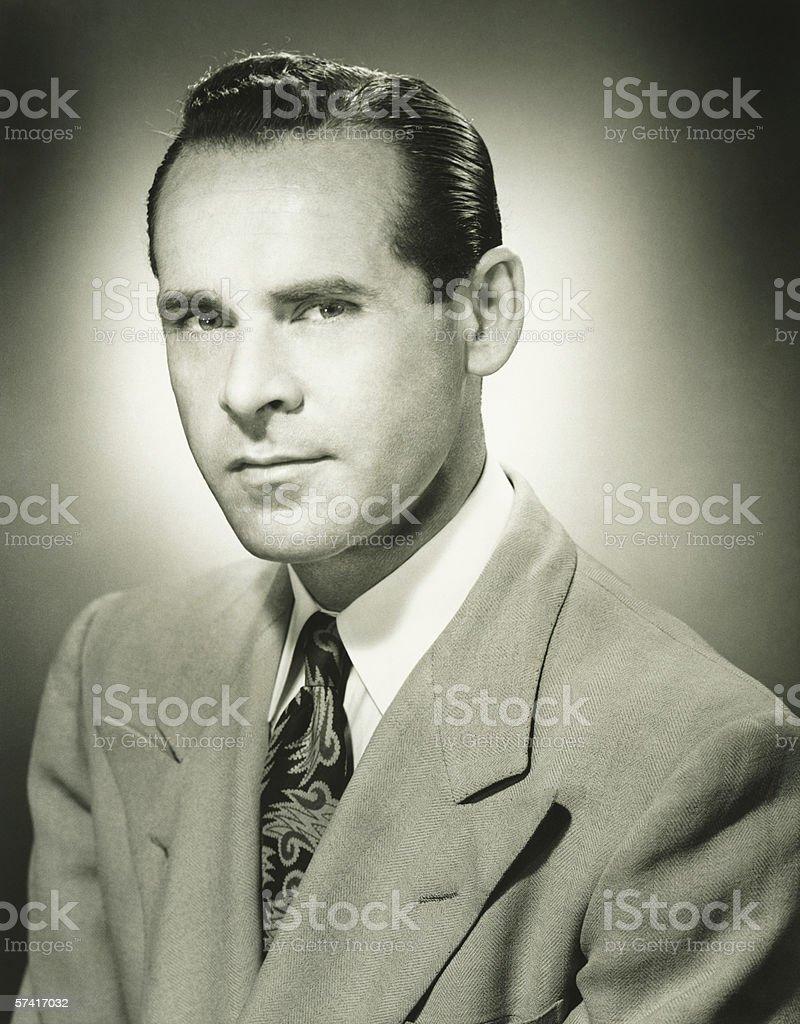 Serious man posing in studio, (B&W), (Close-up), (Portrait) stock photo