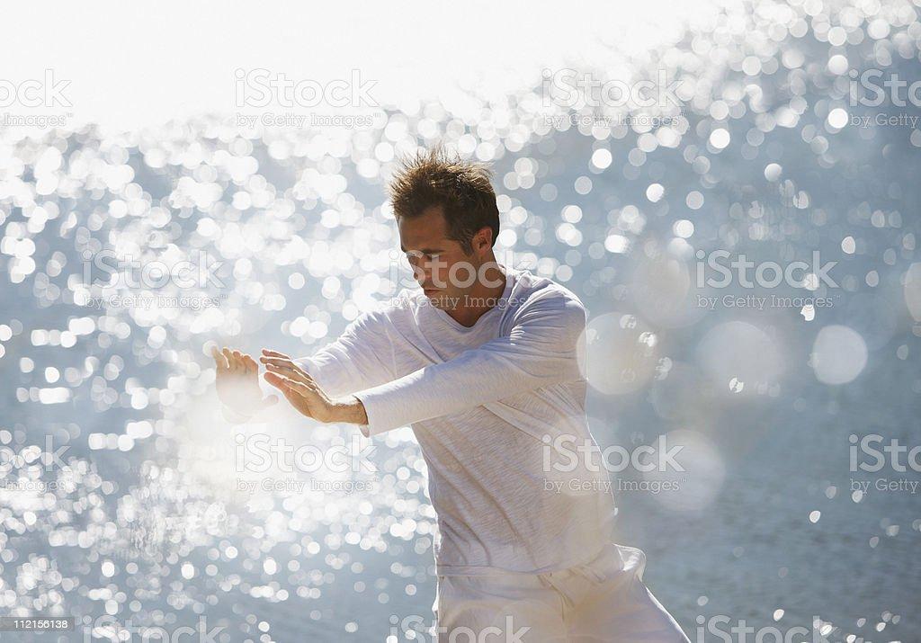 Serious man practicing tai chi royalty-free stock photo