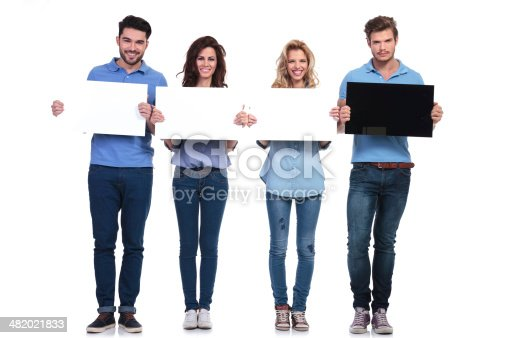 istock serious man presening black card and friends white ones smiling 482021833