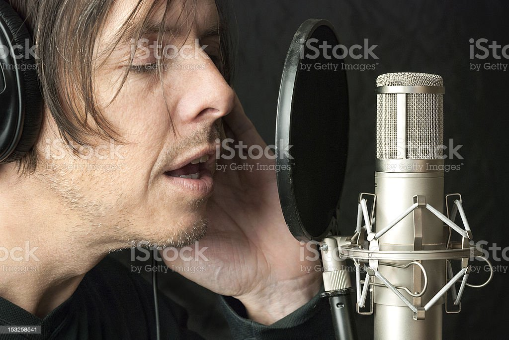 Serious Man Records Vocals In Stuio royalty-free stock photo