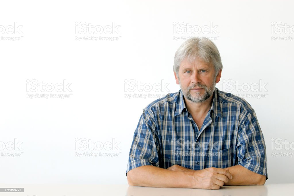 serious man sitting at desk royalty-free stock photo