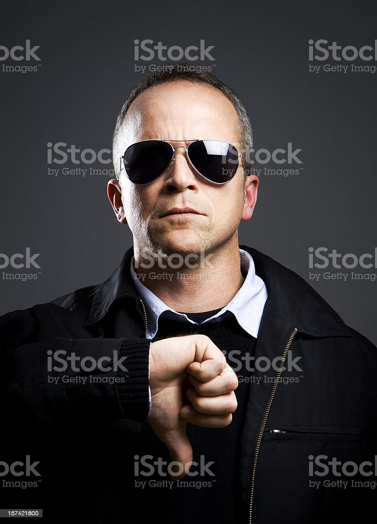 Serious Man Thumbs Down royalty-free stock photo