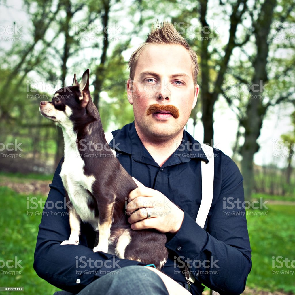 Serious man with dog in knee royalty-free stock photo